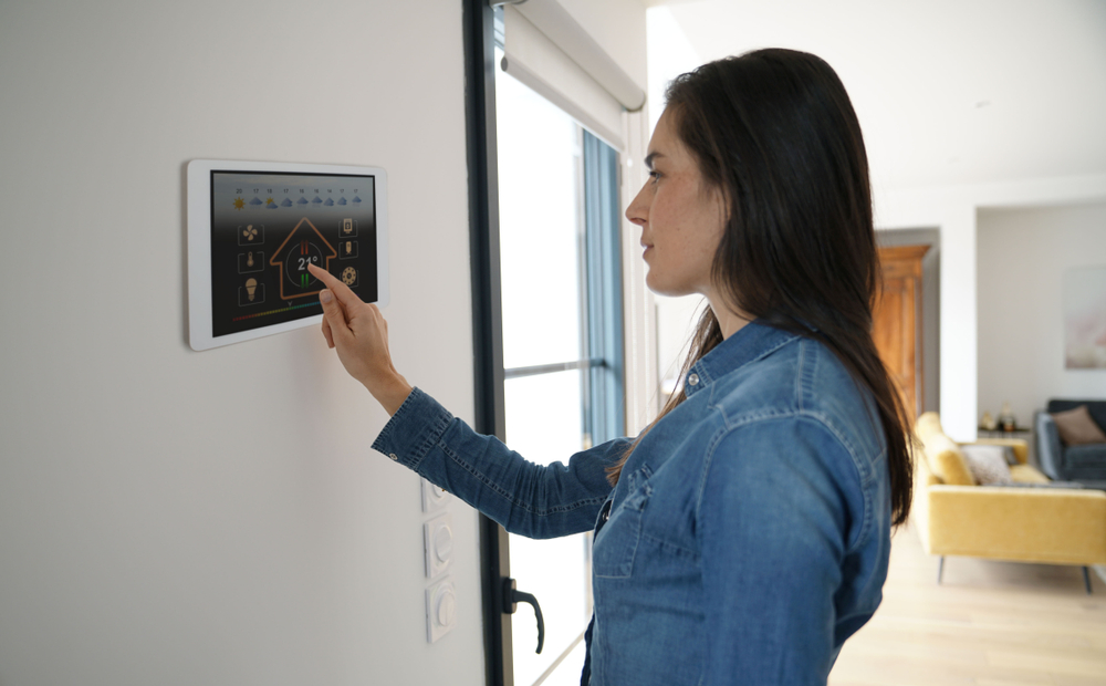 woman adjusting an energy efficiency unit