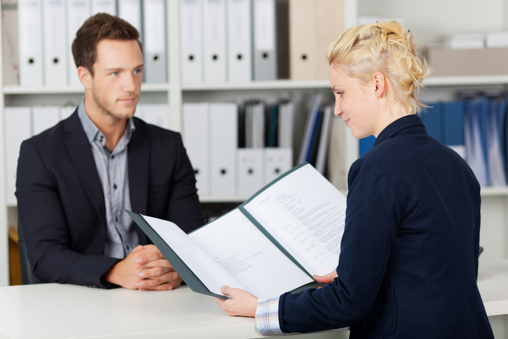 woman interviewing a man; connect with your interviewer